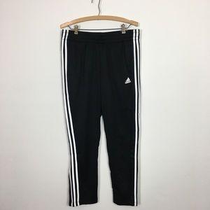 Woman's black adidas Team Sports track pants